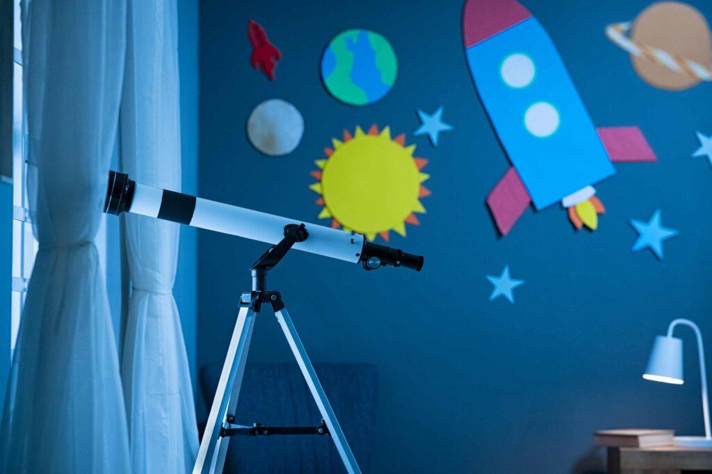 telescope in astronomic childs bedroom
